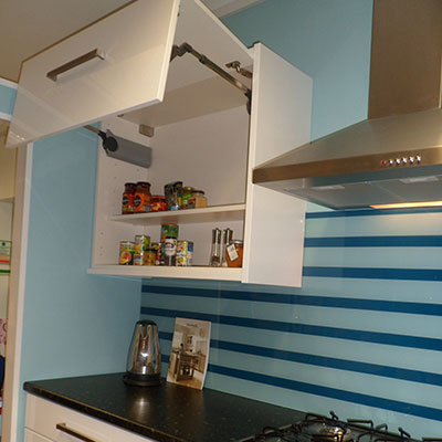 Aventos Up and Over Cupboard open installed as part of kitchen installation in Horsham, West Sussex