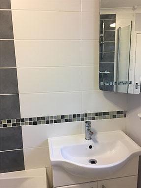 Bathroom Installation in Horsham with tiled mosaic border