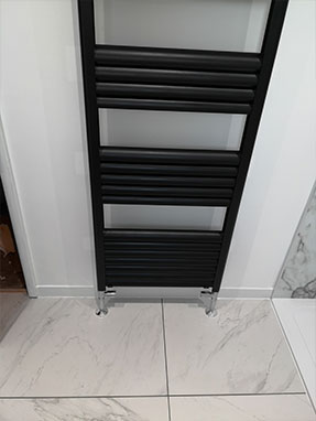 New bathroom radiator fitted in Horsham West Sussex