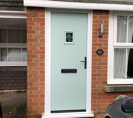 Pastel green composite door installed in Horsham, West Sussex