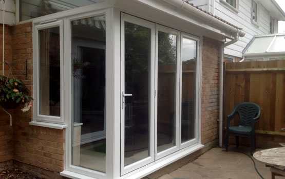 Conservatory with uPVC bi-folding door installed in Horsham, West Sussex