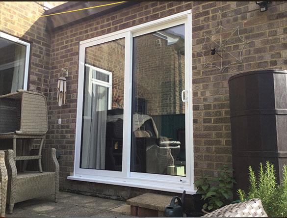 White uPVC Sliding Doors Installed Crawley